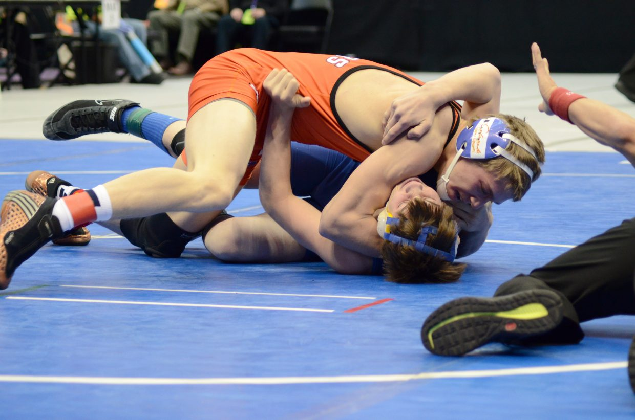 Journey Vreeman picks up a pin Friday in his consolation match in the 160 lb. bracket.