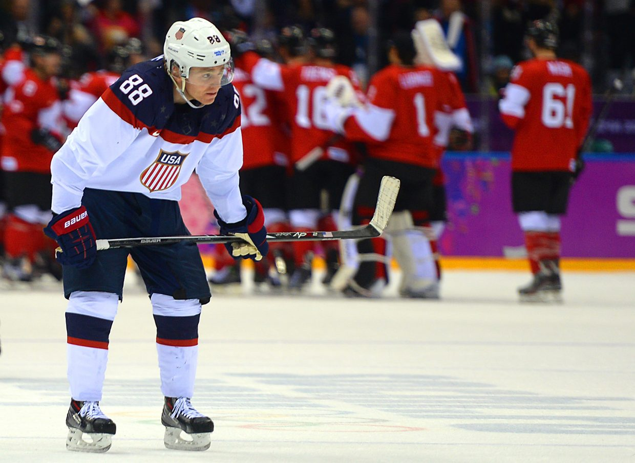 Patrick Kane skates away as the Canadians celebrate advancing to Sunday's gold medal game at the 2014 Winter Olympics.