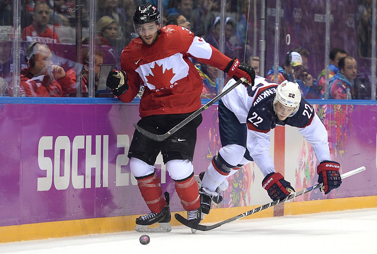 Kevin Shattenkirk gets off a shot Friday in the U.S.-Canada matchup in the semifinals of the men's hockey tournament at the 2014 Winter Olympics.
