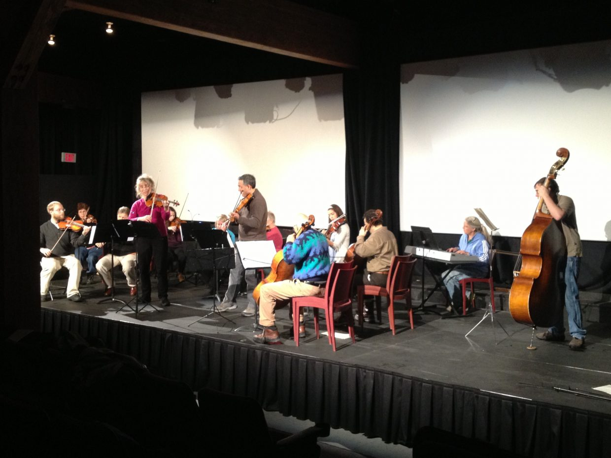 Steamboat Chamber Orchestra plays with Paul Chou leading the group. The orchestra consists of local cellist John Sant'Ambrogio along with Chou and 15 local musicians.