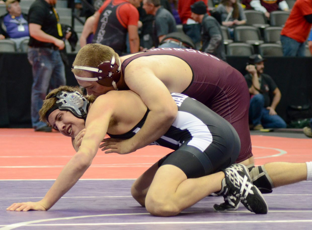 Cody Constine runs around his opponent to score a takedown in the quarterfinals of the 2A state wrestling tournament Friday. Constine moved into the semifinals but was stopped there, losing 4-0. He resumes Saturday.