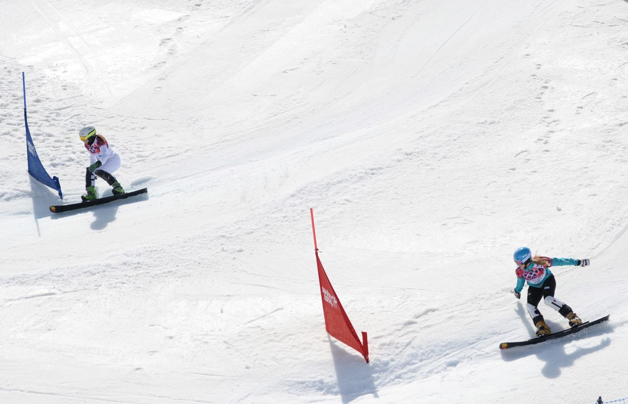 Czech Republic and former Steamboat Springs rider Ester Ledecka, top, races against Germany's Anke Karstens on Saturday in the quarterfinals of the women's parallel slalom event at the 2014 Winter Olympics. Karstens won the matchup to advance.