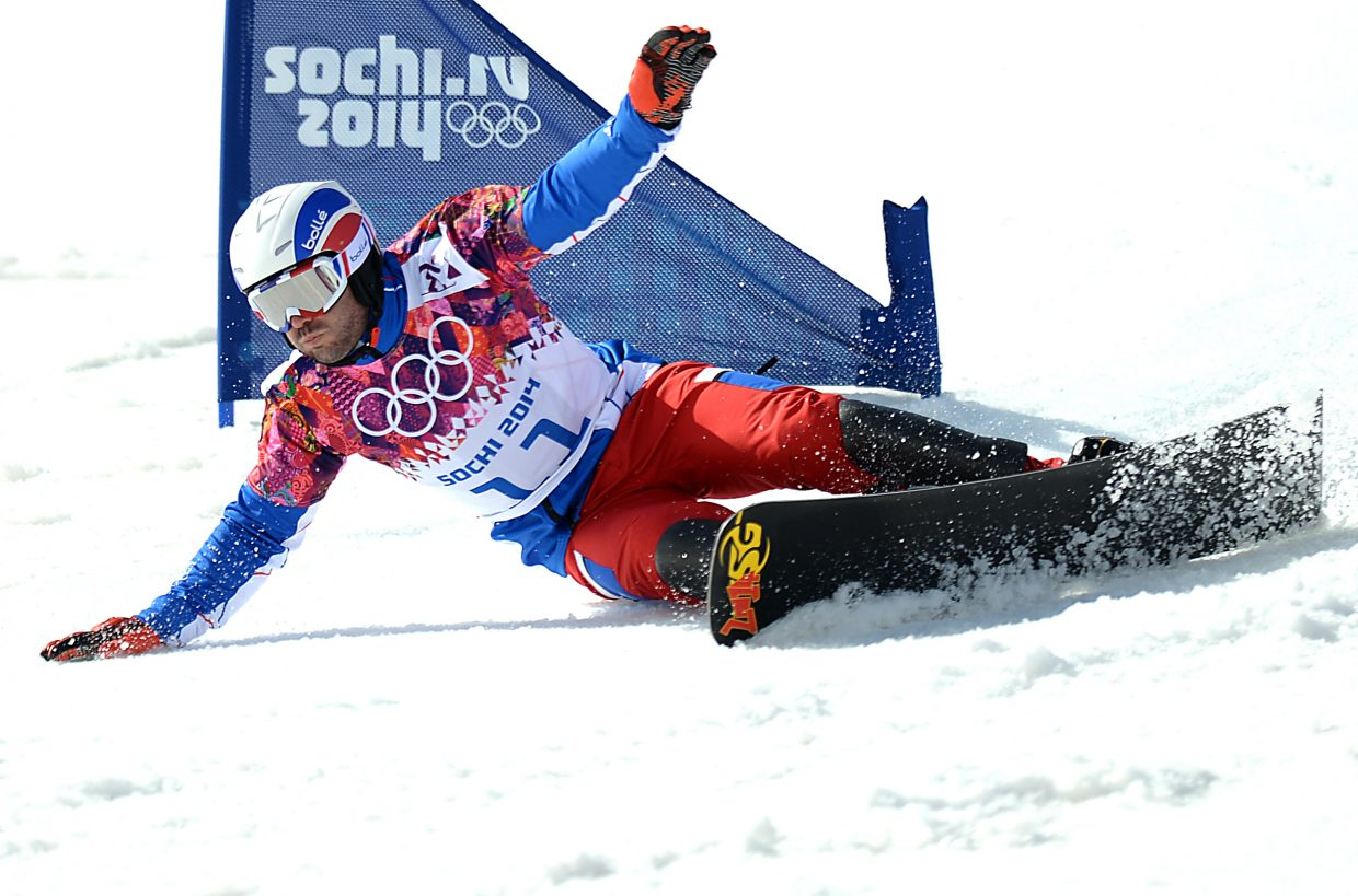 France's Sylvain Dufour gets low to cut a corner during the men's parallel slalom Saturday at the 2014 Winter Olympics.