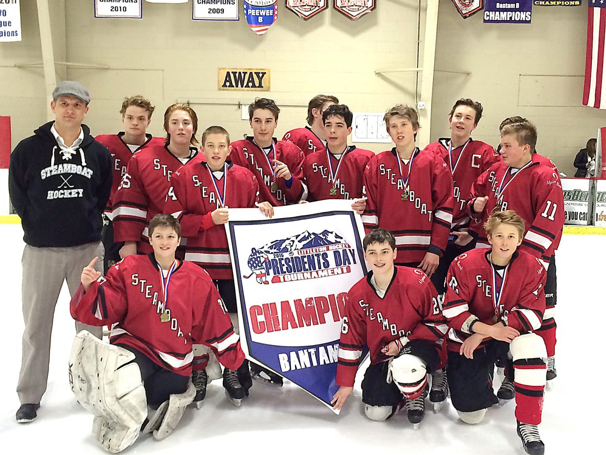 Steamboat's Bantam hockey team poses with its banner won last weekend at a Presidents' Day tournament in Littleton.