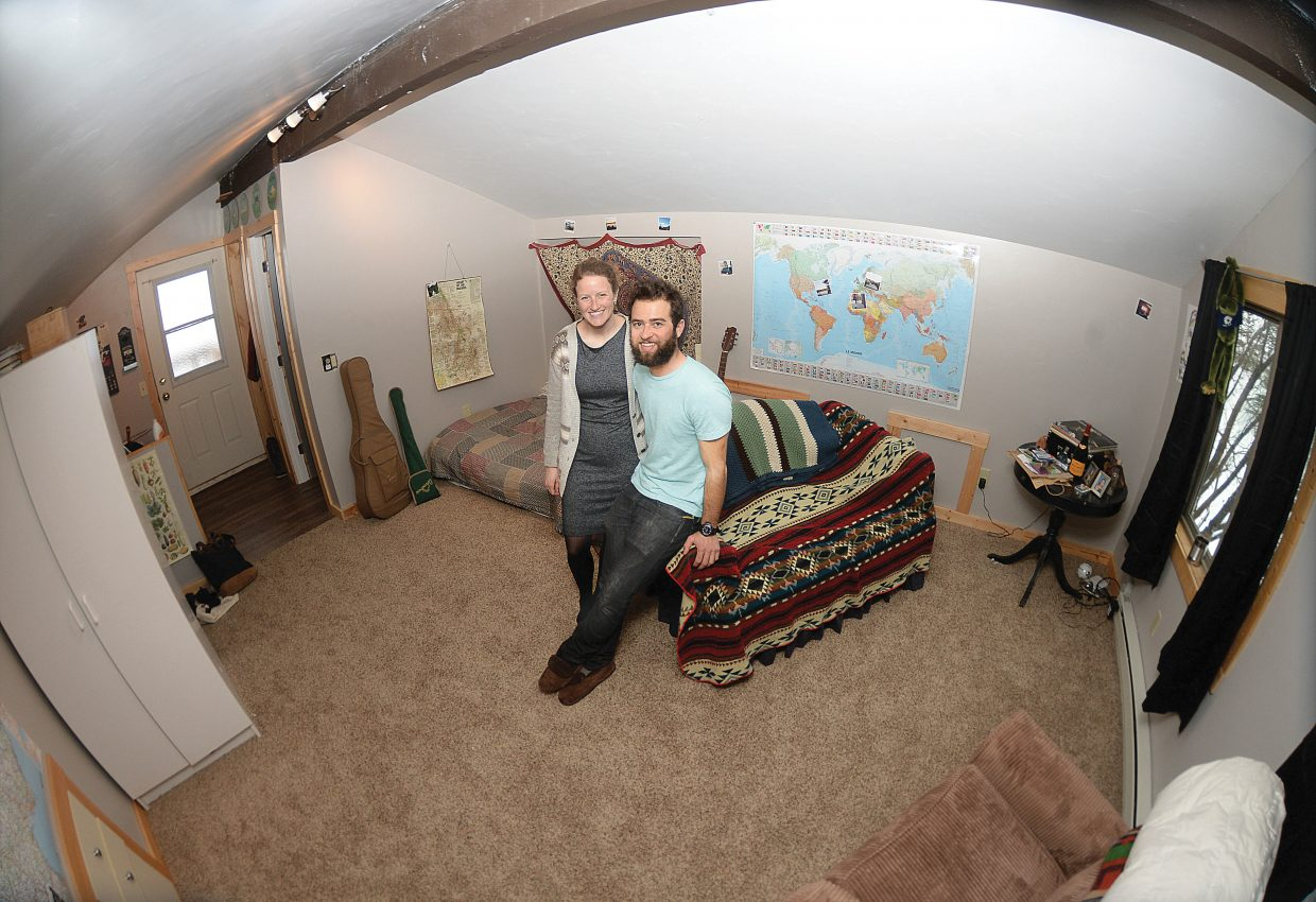 Jamie Burgess and Nicky Gallo felt lucky to find their 440-square-foot apartment above another family's Old Town garage. The couple represent part of a younger generation that doesn't equate success with having a large home.