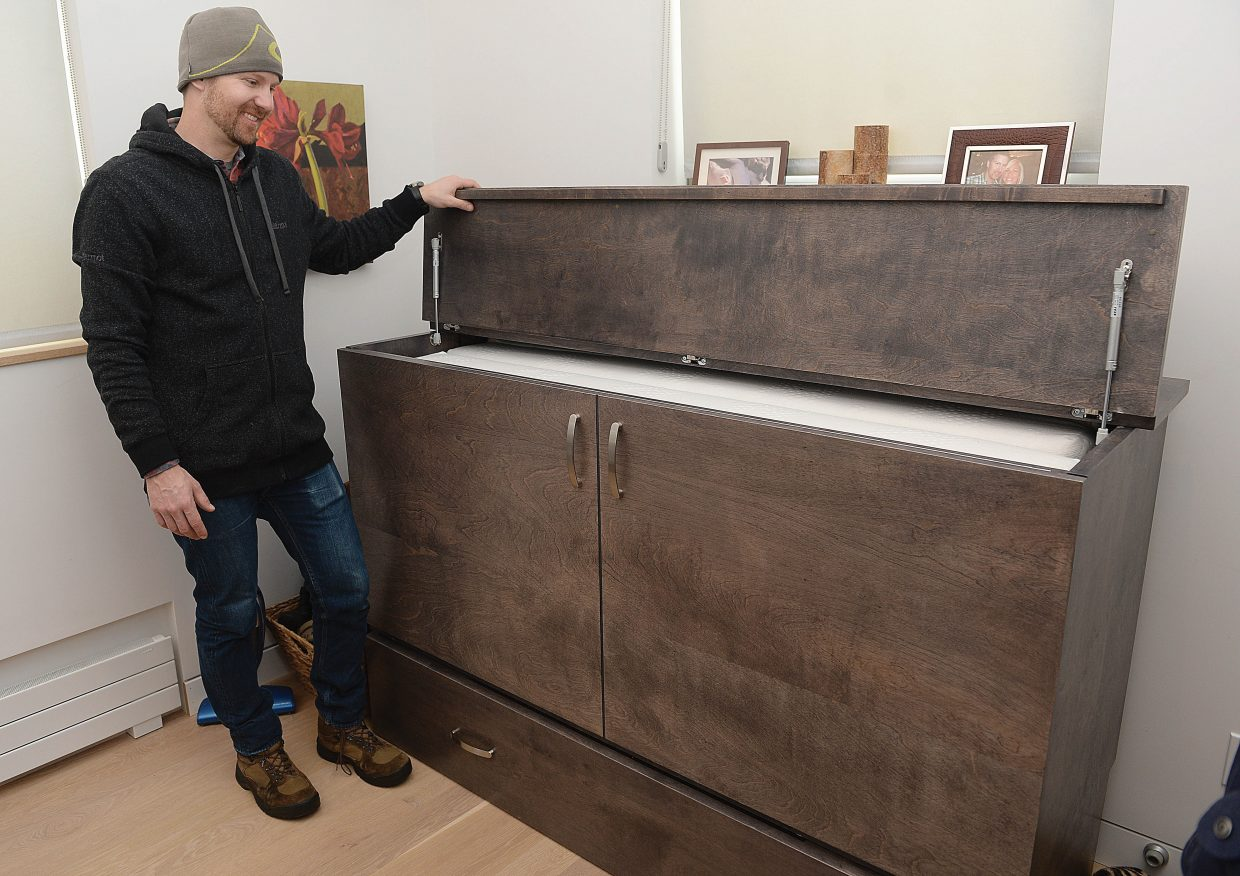 Phillips Armstrong said this unique piece of furniture with a fold-up bed inside allows him to use the couple's spare bedroom as both an office and a guest room when needed.