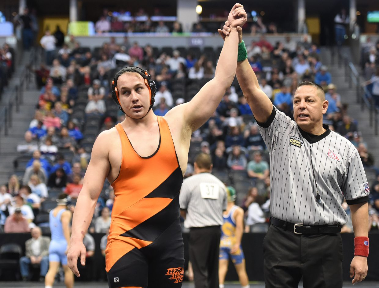 Hayden's Hunter Rummel is named the winner in the Class 2A 220-pound fifth-place match on Saturday at the state wrestling tournament in Denver.