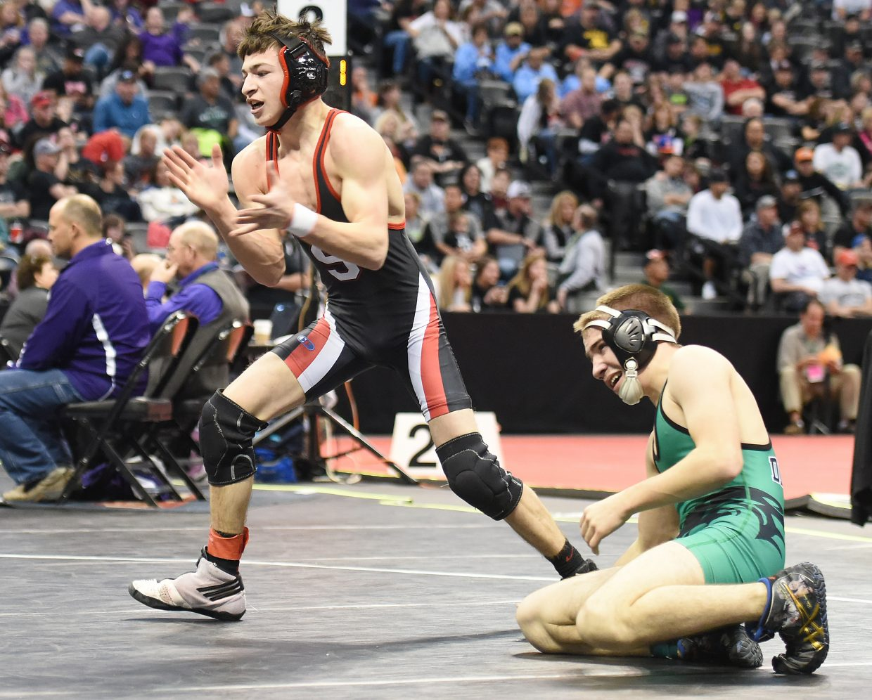 Steamboat Springs junior Colton Pasternak celebrates after beating Delta senior Luke Anderson to secure fifth place in the Class 3A 106-pound bracket at the state wrestling tournament in Denver.