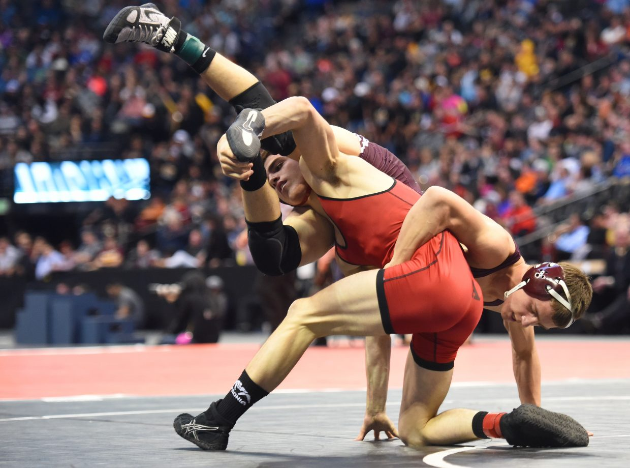 Soroco freshman Jace Logan tries to kick out of trouble Saturday during the Class 2A 145-pound state championship match at the state tournament in Denver. He wasn't successful, ultimately losing the match by a pin in the second period. Steamboat Springs sophomore Hayden Johnson faced a similar fate in the 3A 160-pound finals. Both athletes finished second in their brackets.