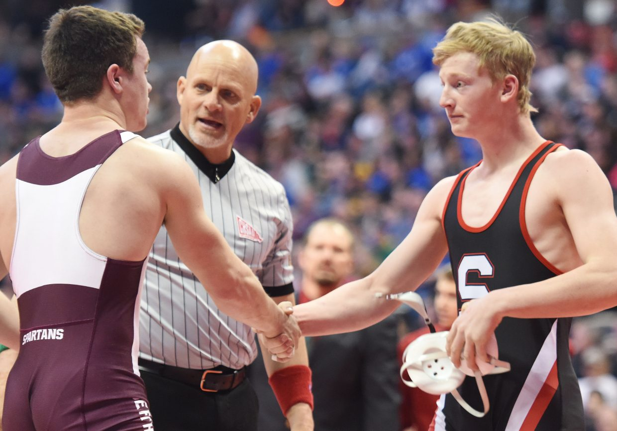 Steamboat's Hayden Johnson shares a handshake with Class 3A 160-pound state champion Jimmy Fate, who pinned Johnson in the final on Saturday.