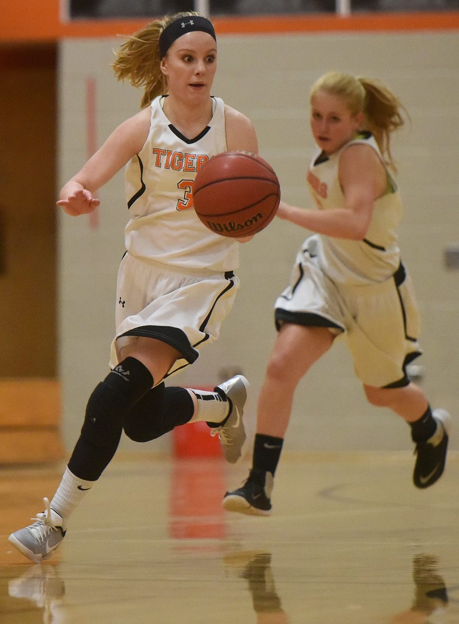 Hayden's Grace Wilkie drives down the court Monday against Caprock Academy.