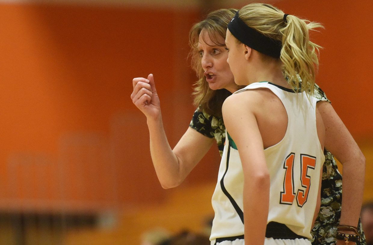 Hayden girls basketball coach Michelle Wilkie coaches Paige Barnes on Monday.