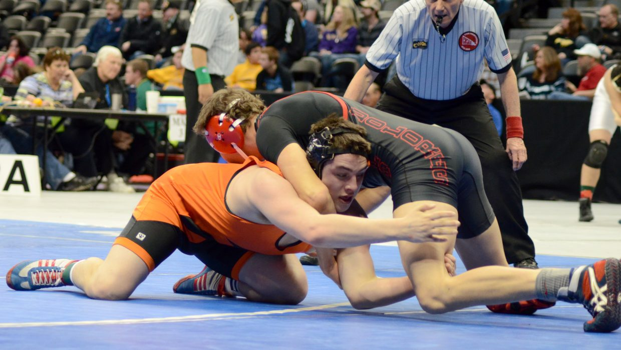 Taylor Lewis took on Dolores High School's Ethen Upton in the third place match of the 182 lb. 2A state wrestling tournament but lost, 10-4.