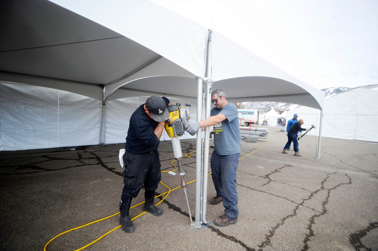 Ezequiel Chavez and Robert Lewis drive stakes into the ground to secure tents to be used during WinterWonderGrass at Steamboat Ski Area. The music festival, which is sold-out, kicks off Thursday with a free concert in Gondola Square from 2 to 5 p.m.