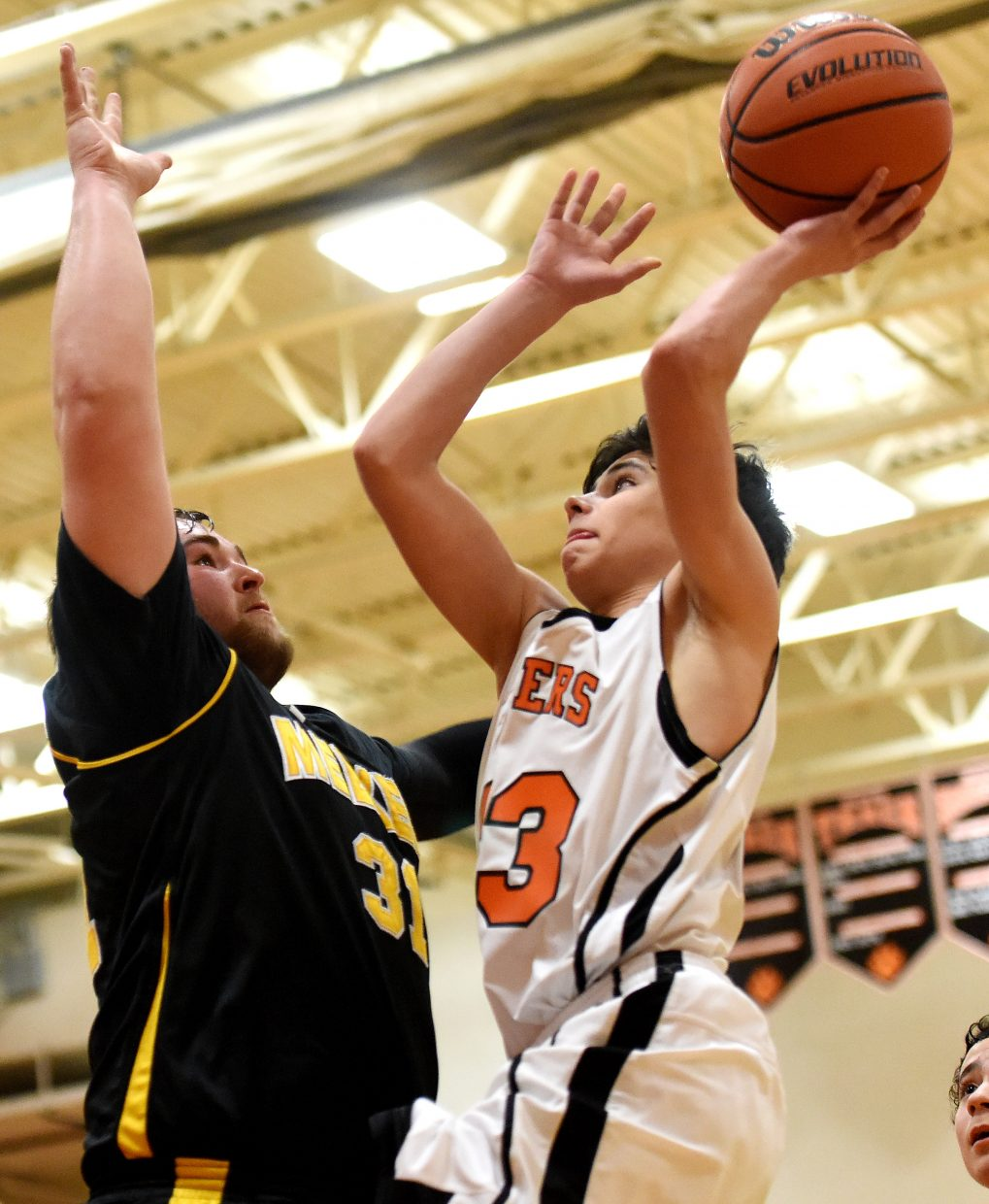 Hayden freshman Patrick Hunter goes up for a shot Monday against Meeker.