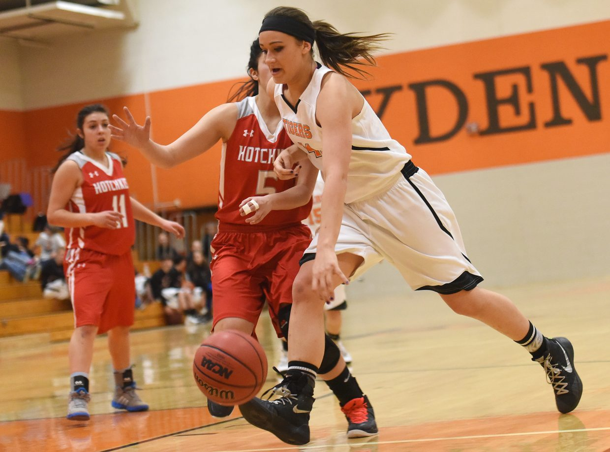 Hayden's Emma Johnson charges toward the basket Monday against Hotchkiss. She scored on the play.