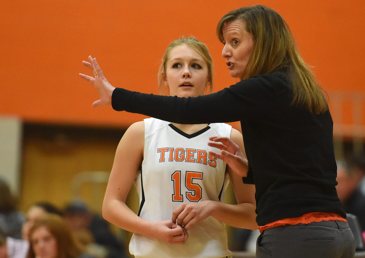 Hayden girls basketball coach Michelle Wilkie passes some advice on to freshman Paige Barnes on Monday.