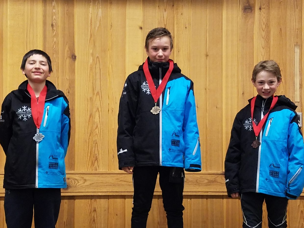 Niklas Malacinski, center, was first, Gunnar Gilbertson, second and Erik Belshaw third off the HS42 hill in the U14 boys special jumping division.
