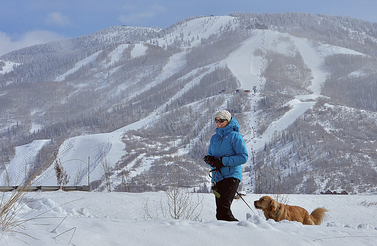 Judy Chovan walks Annie along the Yampa River Core Trail Monday morning in Steamboat Springs. Last weekend's snow storms gave the Yampa Valley a more wintry feel with the start of March less than a week away.