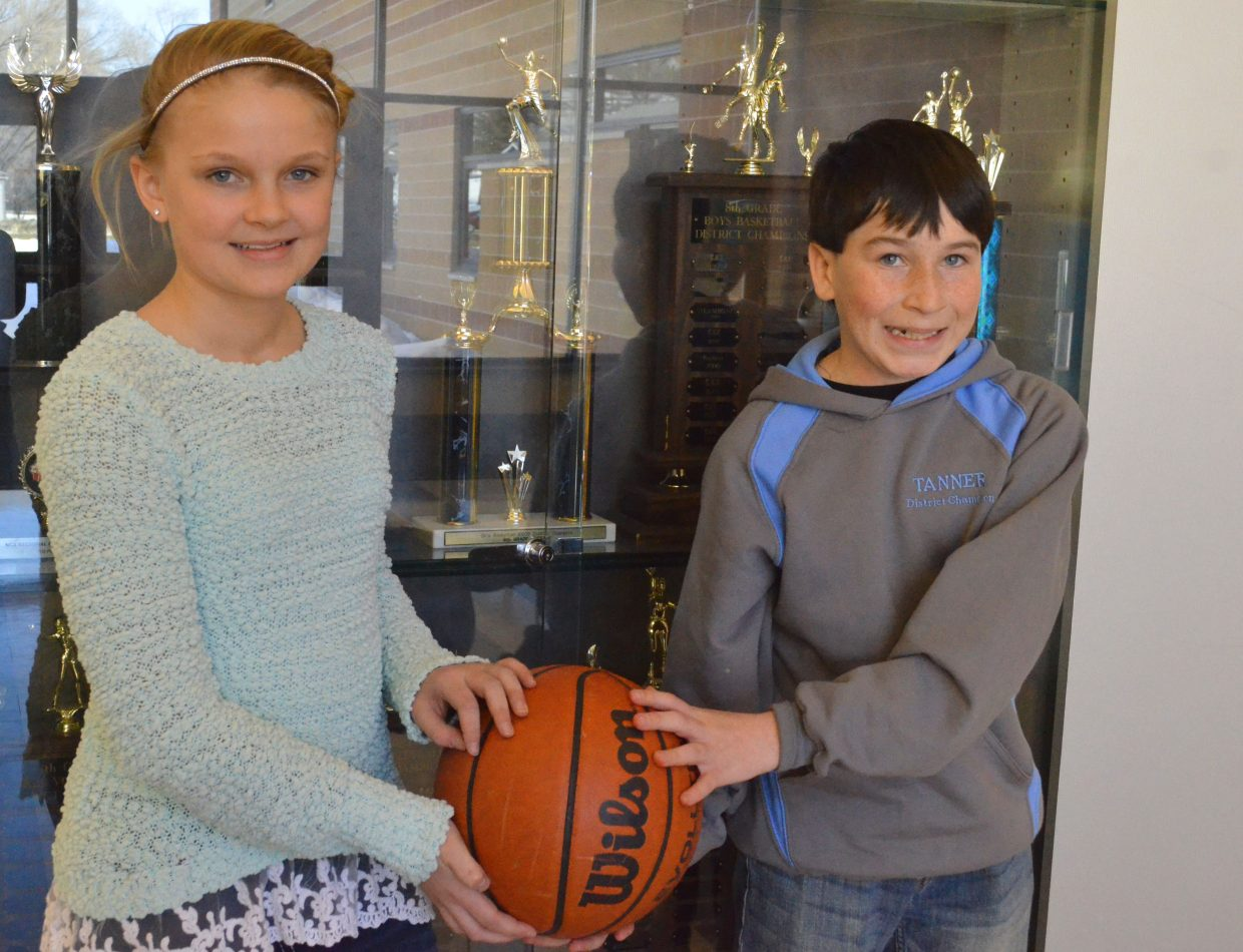 Jacie Evenson, left, and Tanner Etzler display their sport of choice in front of the Craig Middle School trophy case. The two competed in Salida Saturday for the state round of the Elks National Hoop Shoot Free Throw Contest. Etzler took second in the 12- to 13-year-old boys division and Evenson won the 10- and 11-year-old girls, advancing to the regional level, which takes place in Denver in March. Etzler will also be able to attend if the first-place winner is unable to compete.