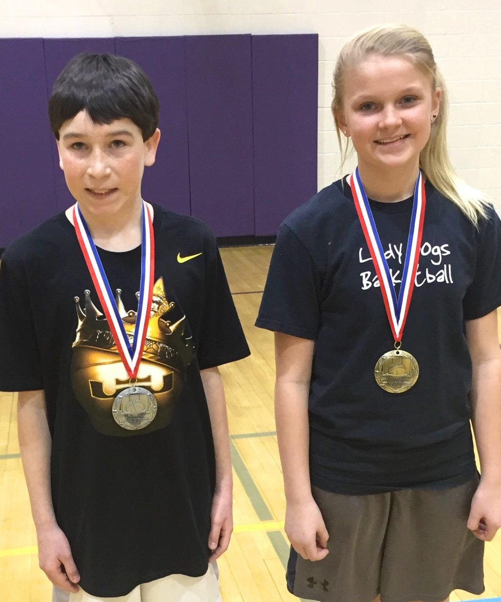 Craig's Tanner Etzler, left, and Jacie Evenson display their medals won at the state round of the Elks National Hoop Shoot Free Throw Contest. The two both won at the local and district levels, with Evenson qualifying to move on to regionals next.