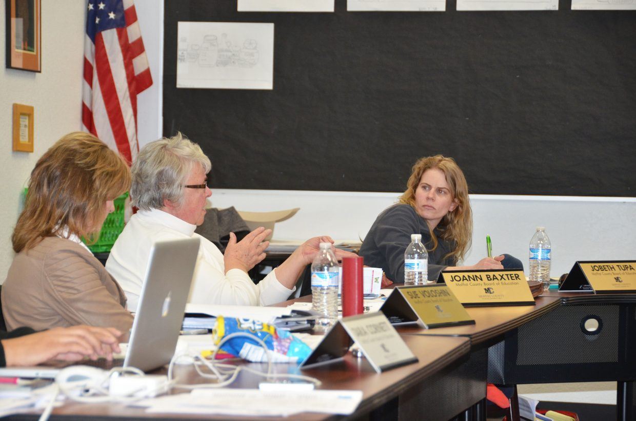 Moffat County School Board members Sue Voloshin, left, Jo Ann Baxter and JoBeth Tupa consider the early steps of a superintendent search during Tuesday's work session.