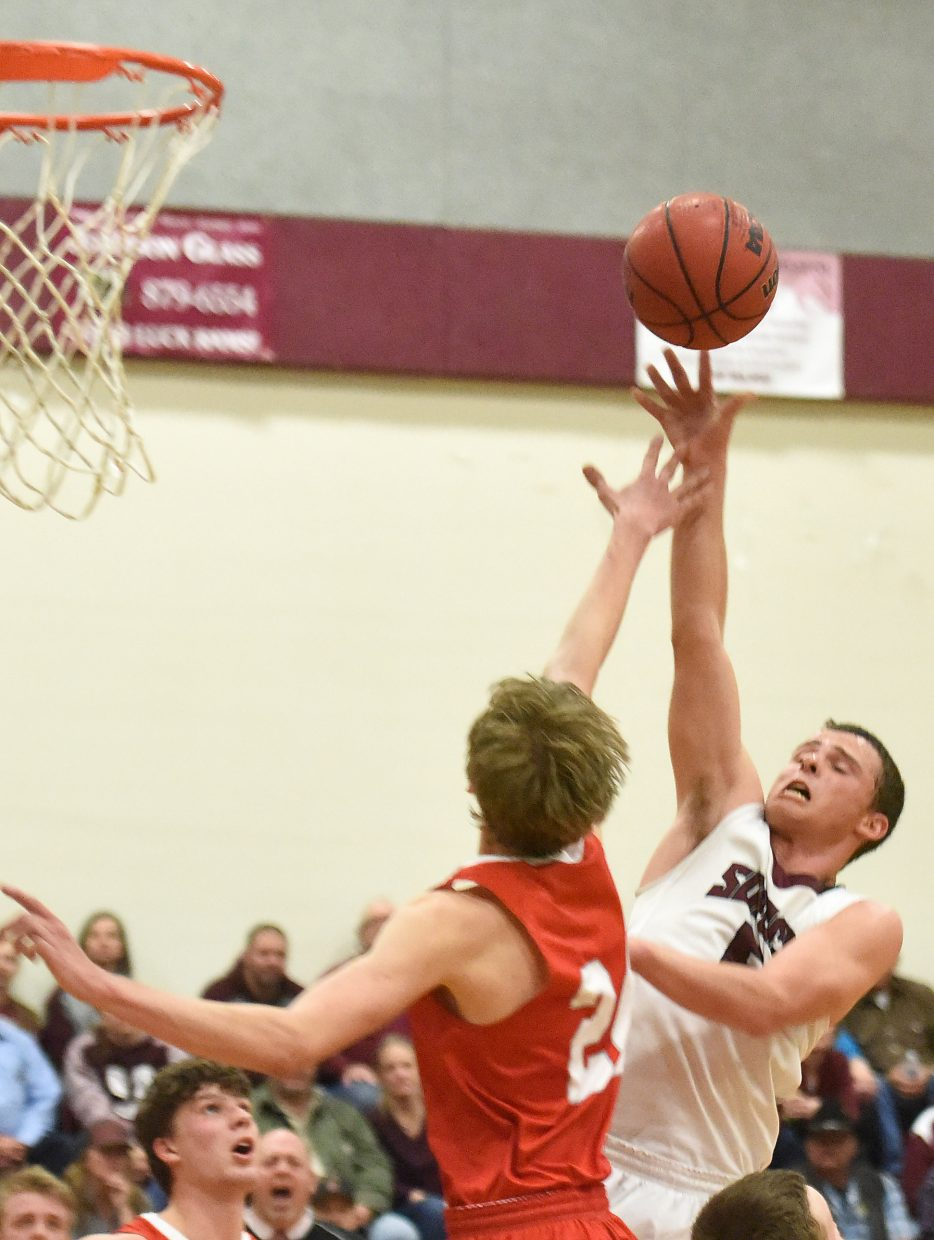 Soroco's Eric Logan tries to get a shot over the defense Tuesday against Hotchkiss.