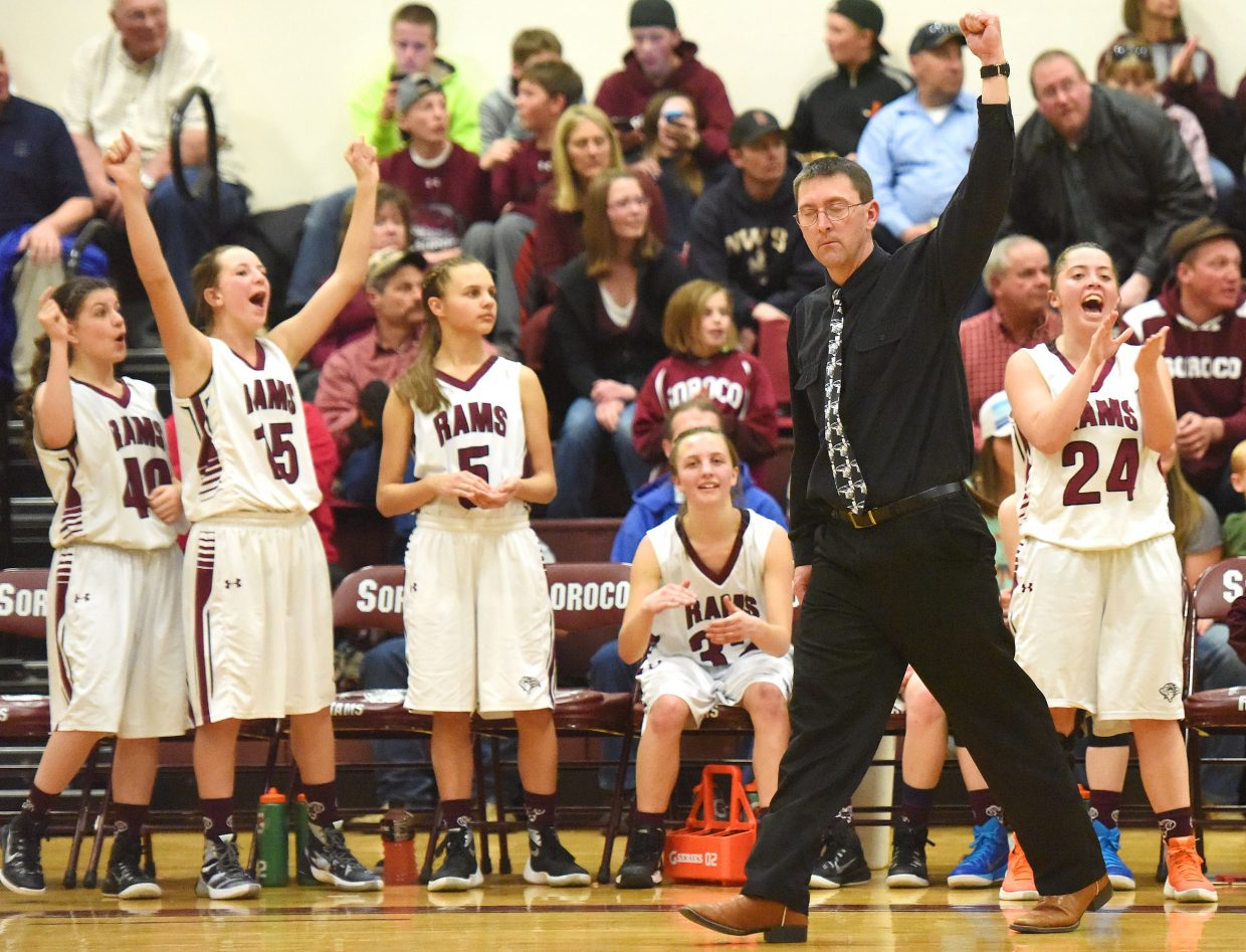 Soroco coach David Bruner throws his fist in the air as the buzzer sounds Tuesday on his team's 62-32 home win against Meeker.