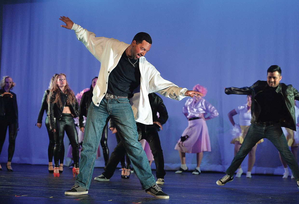 """Kaulana Papalimu dances in a rendition of """"Grease"""" during a rehearsal for the 2015 Steamboat Dance Theatre's performance. This is the 43rd year for the show, which will have performances beginning at 7 p.m. Thursday through Saturday and a matinee at 12:30 p.m. Saturday."""