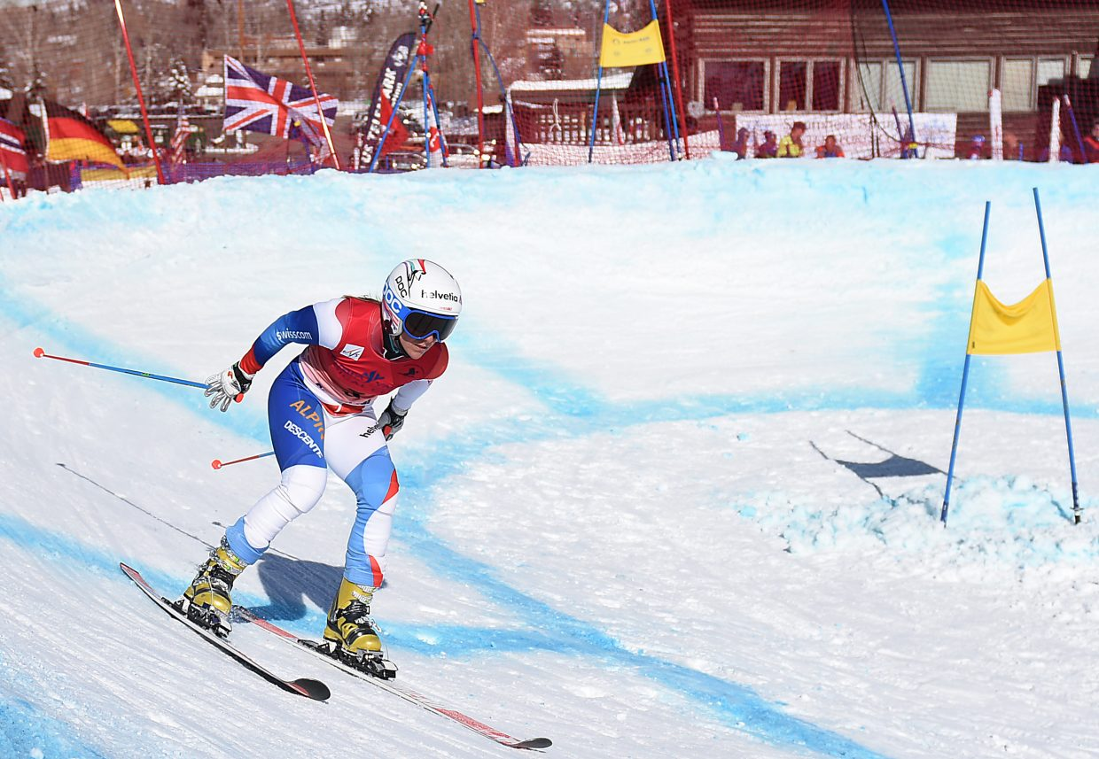 Swiss skier Amelie Reymond flies around the reipelykkje, a 360-degree banked turn, during the sprint classic telemark race at Howelsen Hill Tuesday. The event was the first of four days of Telemark racing action as Steamboat Springs hosts the 2015 FIS Telemark World Championships. Reymond won the women's race Tuesday in convincing fashion.