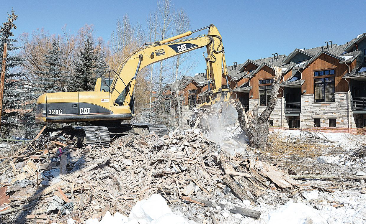 An excavator removes the remains of a home that was located on the corner of Yampa and Sixth streets in downtown Steamboat Springs. The home was removed as developers begin a new project.