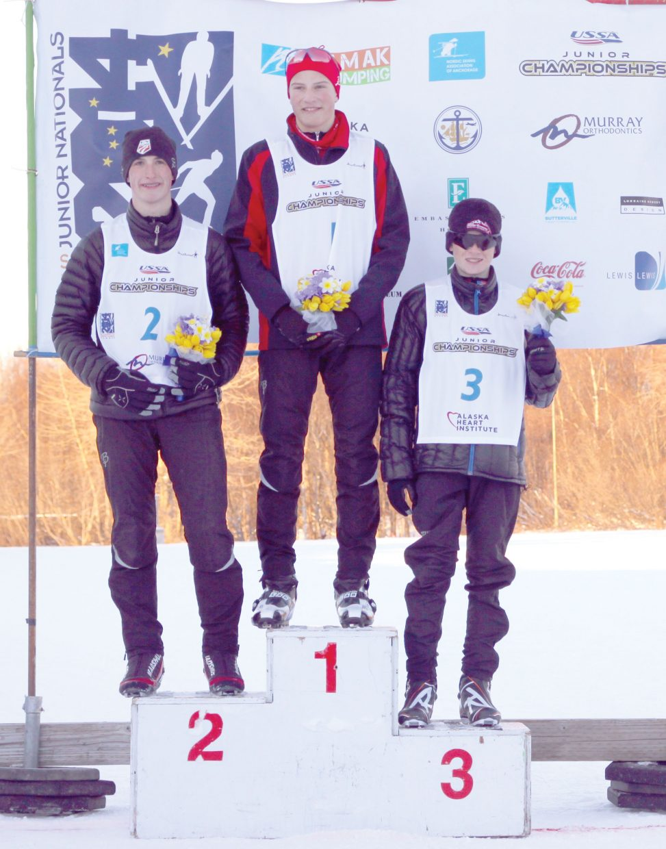 Ben Loomis, center, of the Central Division, won the boys Nordic combined title at this week's Junior National Championships. He shared the podium with Steamboat Springs skiers Grant Andrews, left, who finished second and Finn O'Connell, who finished third.