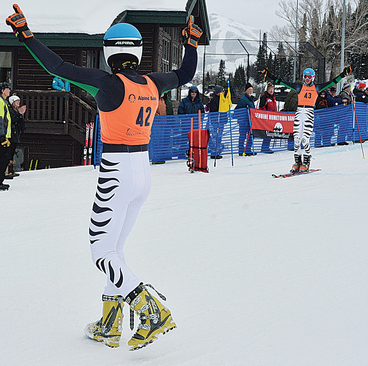 German skier Jonas Schmid celebrates as his teammate Tobias Mueller crosses the finish line of Wednesday's FIS Telemark World Championship team Event at Howelsen Hill. The Germans placed third after beating the Norwegians in the small finals. The World Championships will continue Thursday at 10 a.m. with the finals of the Parallel Sprint Classic.