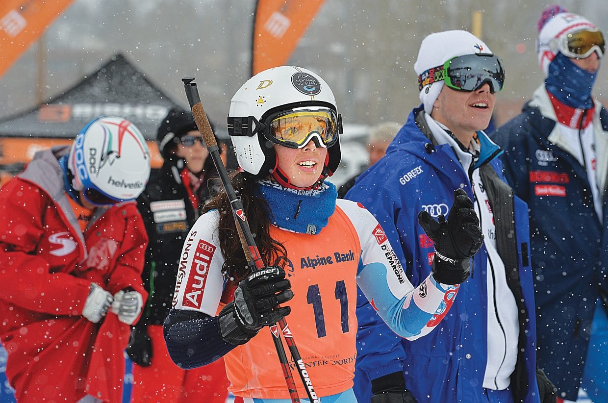 France's Argeline Tan Bouquet can't hide her anticipation as her teammate races against the Swiss team in the finals of the team event at the 2015 FIS Telemark World Championships in Steamboat Springs Wednesday. Her team lost to the Swiss by a score of 2-1.