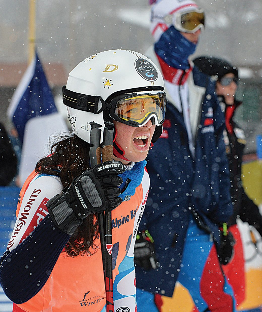 France's Argeline Tan Bouquet cheers as her teammate races against the Swiss team in the finals of the team event at the 2015 FIS Telemark World Championships in Steamboat Springs Wednesday. Her team lost to the Swiss by a score of 2-1.