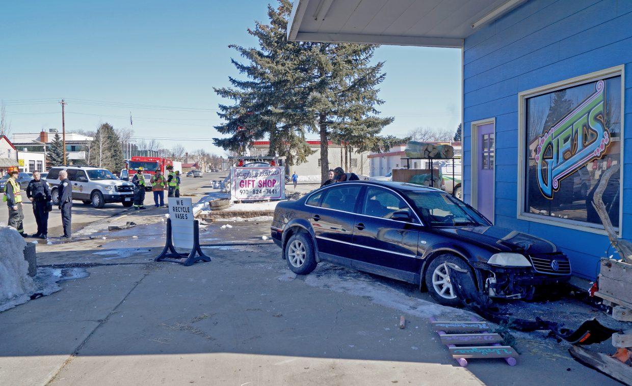 A 2004 black Volkswagen Passat was halted by a curb just inches away from The Flower Mine on Thursday afternoon.