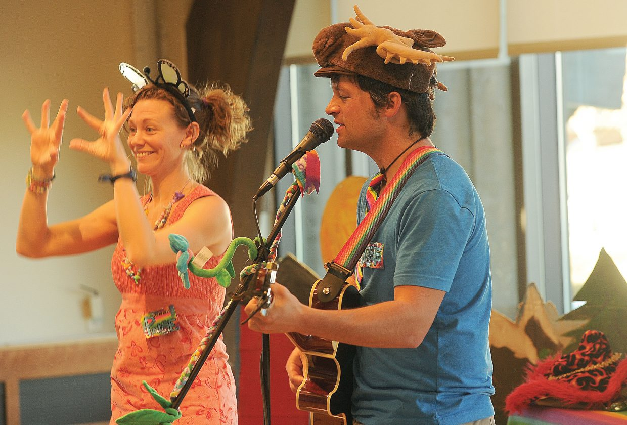 Jeff Kagan and Paige Doughty, of Jeff and Paige, perform to a large crowd at the Bud Werner Memorial Library on Wednesday afternoon. The musical group blends children's music and science to help teach children about the world they live in.