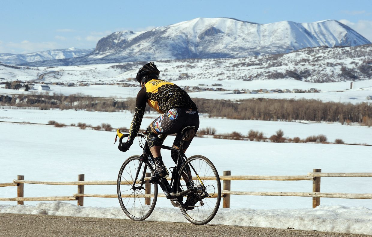 Clear blue sky, and spring like temperatures helped cyclist Chris Tamucci enjoy the day as he headed out along Routt County Road 33 on Wednesday afternoon.