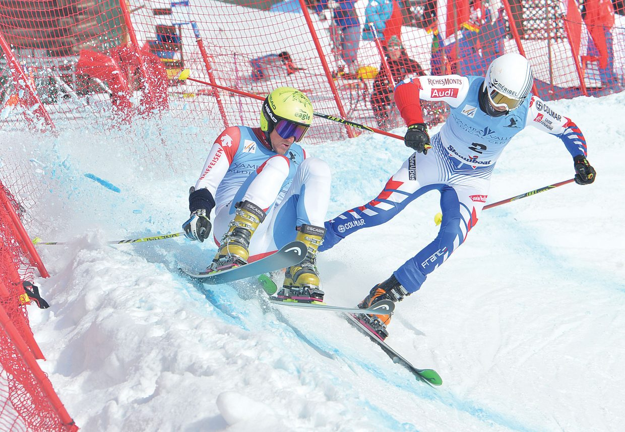 France's Lau Philippe attempts to make his way around Swiss skier Bastian Dayer in the quarterfinals of Thursday's FIS Telemark World Championships men's parallel sprint. The World Championships will continue Friday at 10:30 a.m. with the classic race on Vagabond at Steamboat Ski Area.