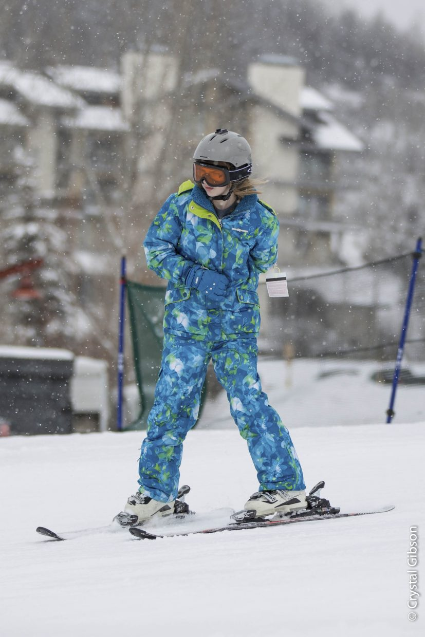 Maddison Williams, a 15-year-old from North Dakota, skis Wednesday at Steamboat Ski Area during the week-long Sunshine Kids camp for teen cancer patients.