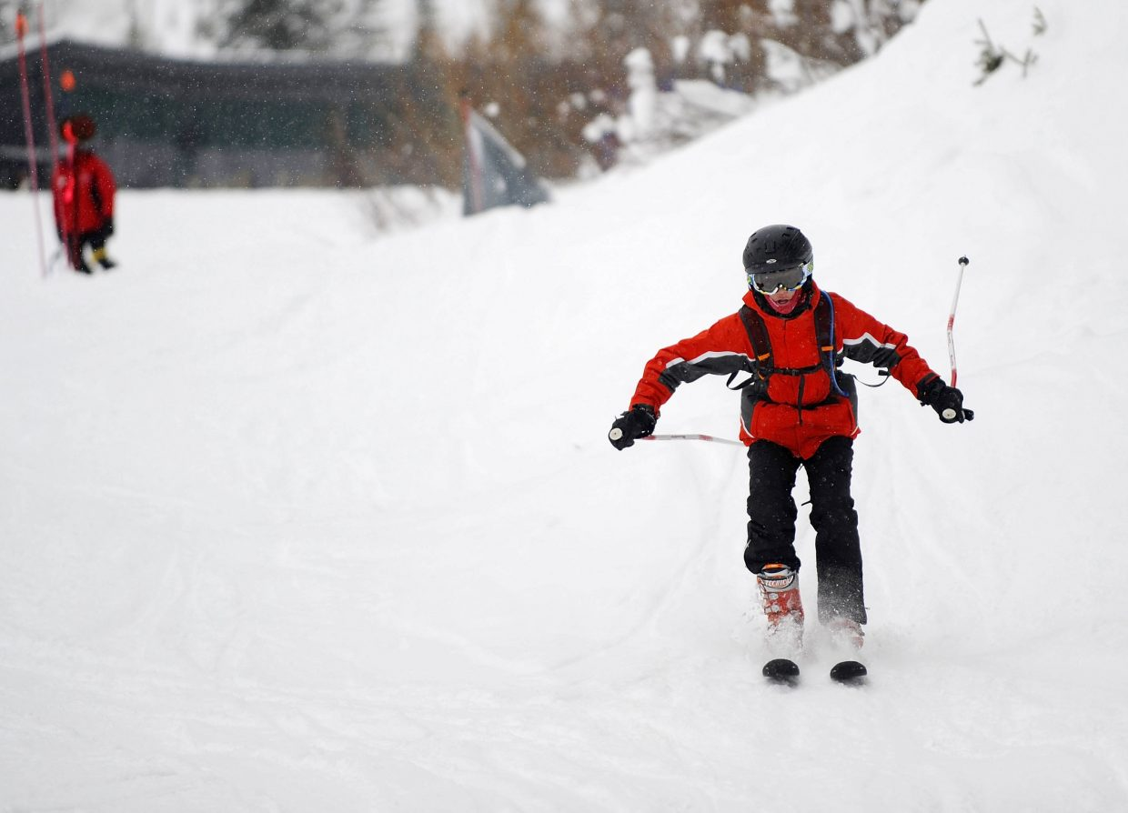 Carson Hilliker, 15, of Denver, skis Wednesday at Steamboat Ski Area during the week-long Sunshine Kids camp for teen cancer patients.