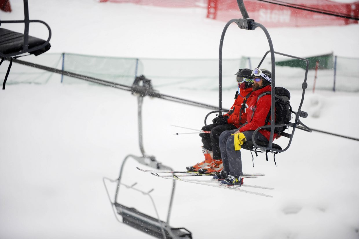 Sunshine Kid Carson Hilliker, 15, of Denver, rides up a ski lift with instructor Greg Dalsis Wednesday at Steamboat Ski Area.