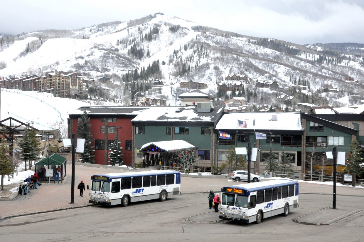 Passengers board Steamboat Springs Transit buses at the Gondola Transit Center Monday afternoon. The bus service saw a record 12,034 riders on Saturday due to the WinterWonderGrass music festival.
