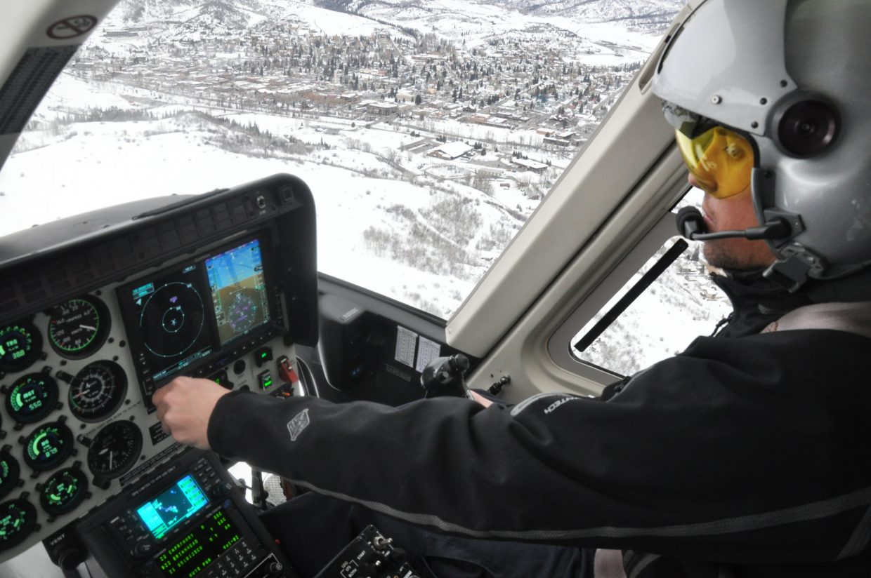 Ryan Cutter pilots a new medical helicopter over Steamboat Springs during a test flight on Friday afternoon. The new air ambulance service from Classic Lifeguard will begin operating out of the Steamboat Springs Airport on Saturday.