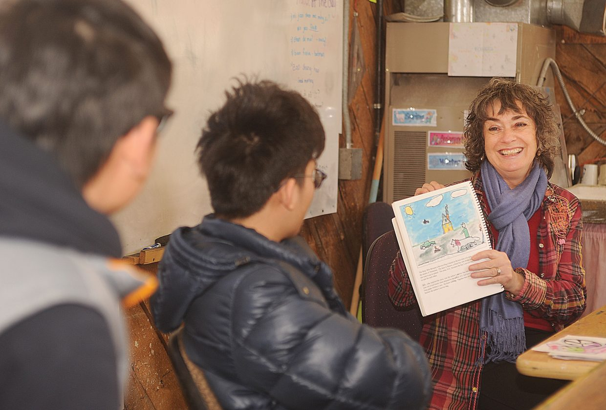 Children's author Trish Carpenter shares her ideas with Claire Gittleman's art class Wednesday at The Lowell Whiteman School. The students in the class are illustrating Carpenter's latest children's book.
