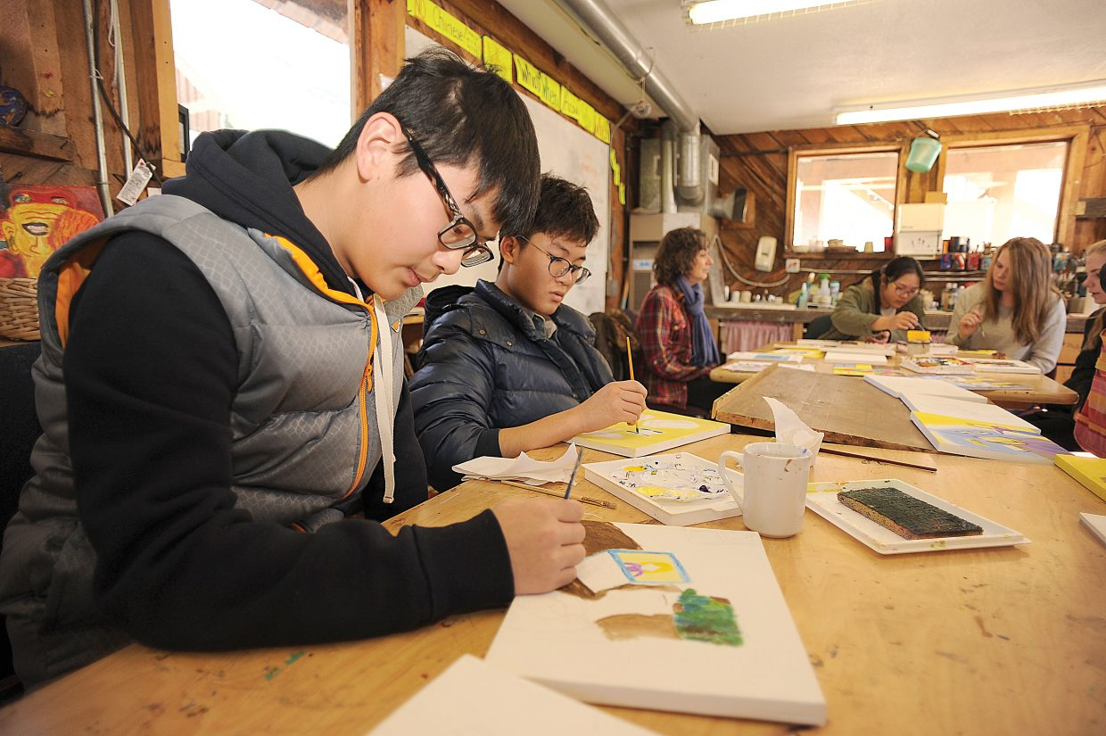 Leo Lin works on an illustration for Trish Carpenter's children's book during his art class at The Lowell Whiteman School. Art teacher Claire Gittleman teamed up with Carpenter to make illustrating the book part of a class project.