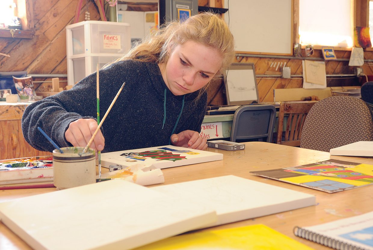 The Lowell Whiteman School freshman Paula Cooper works on an illustration for a children's book written by Trish Carpenter. Carpenter teamed up with Lowell Whiteman art teacher Claire Gittleman to make illustrating the book part of a class project.