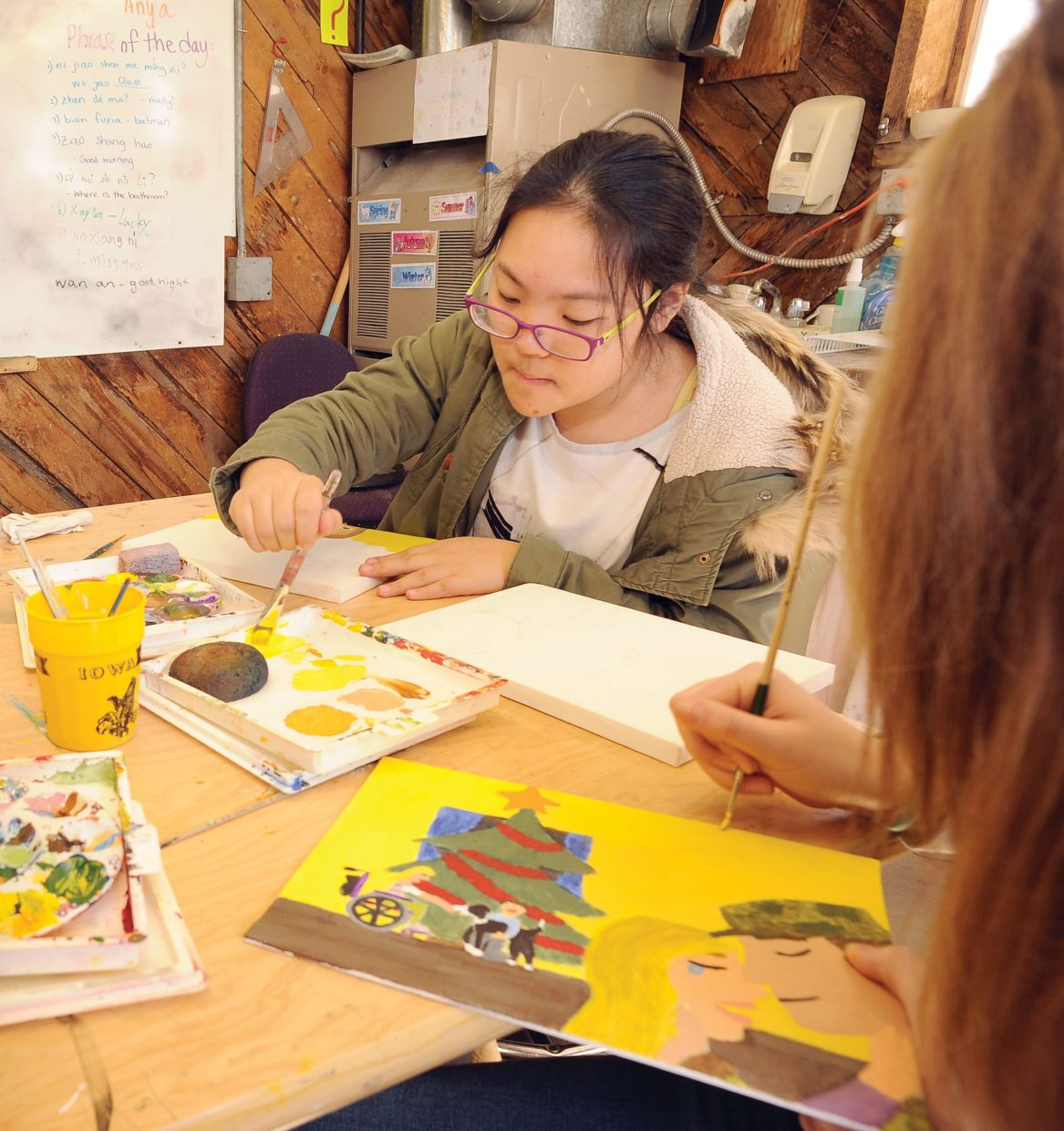Art student Merry Ma works on an illustration for Trish Carpenter's most recent children's book. The students in Claire Gittleman's art class at The Lowell Whiteman School have made illustrating the book part of a class project.