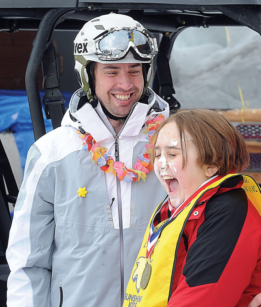 Lauren Rae Shock reacts after getting a peck on the cheek from Olympic silver medalist Johnny Spillane at the Sunshine Kids Winter Games at the base of the Bashor ski run at Steamboat Ski Area. Shock's new friends had surprised her with a face of whipped cream as she headed to the awards stand, and Spillane couldn't pass up an opportunity to make the young girls day.