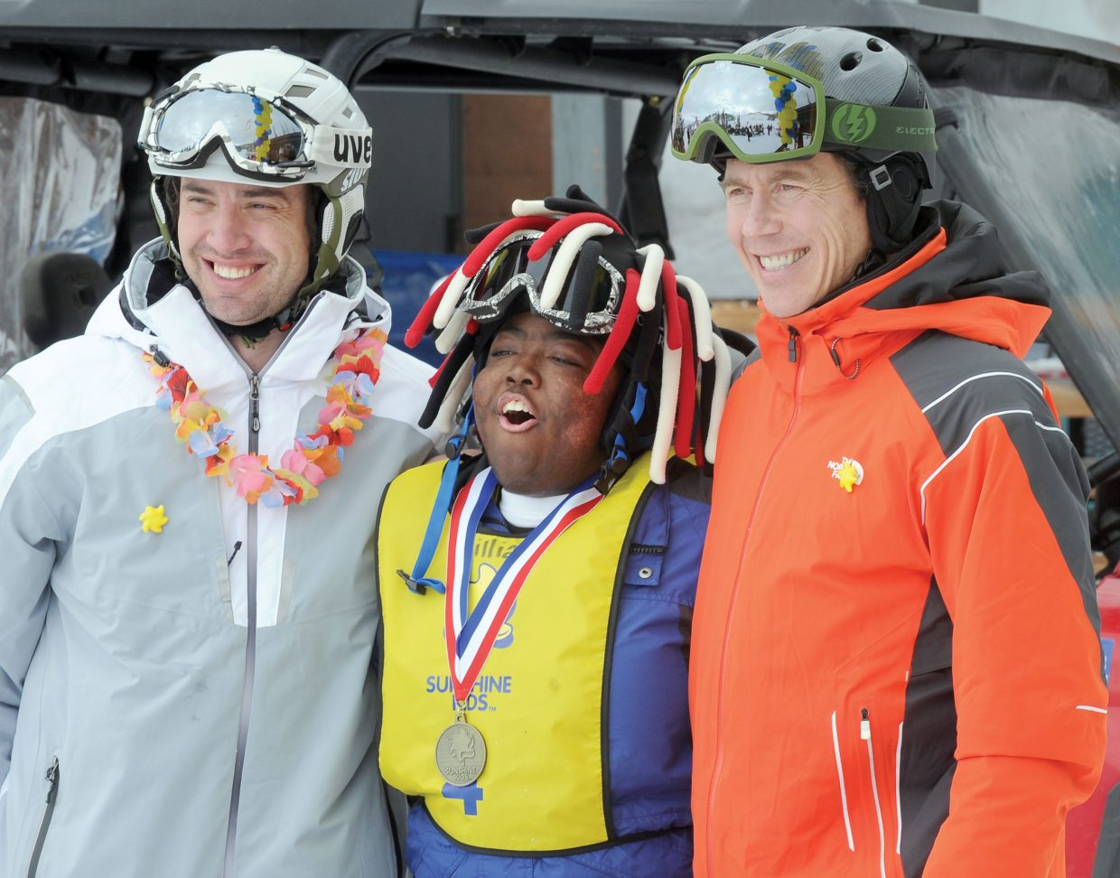 William Wallace, of Birmingham, Ala., gets his medal from Olympic silver medalist Johnny Spillane, left, and Sotheby's Cam Boyd. Sotheby's Reality has been a longtime supporter of STARS and the Sunshine Kids programs in Steamboat Springs.